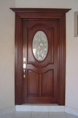 Puerta de ovalo en madera de caoba con marco envolvente y - Puertas de calle de madera ...